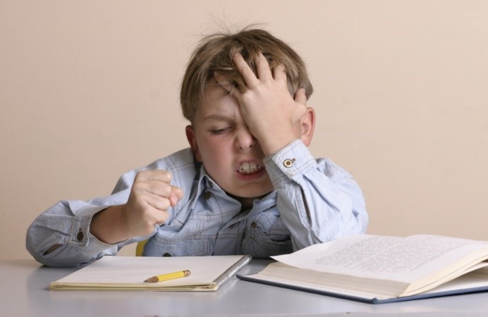 frustrated kid holding his head